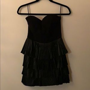 Black strapless dress with leather pleating